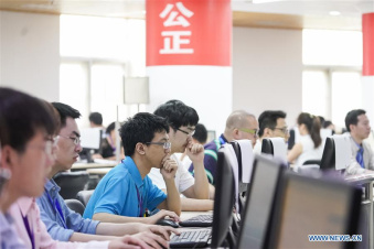 Teachers score examination papers of national college entrance examination in Beijing