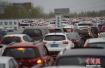 """北京试点拥堵路段""""拉链式""""通行 效率或增15.6%"""