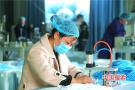 河南光山县首条一次性口罩生产线投产