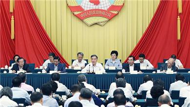 全国政协十三届常委会第三次会议闭幕